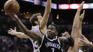 Brooklyn Nets' Joe Johnson drives between San Antonio