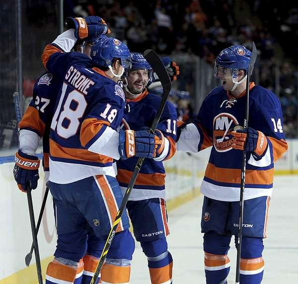 Islanders teammates celebrate center Anders Lee's score in
