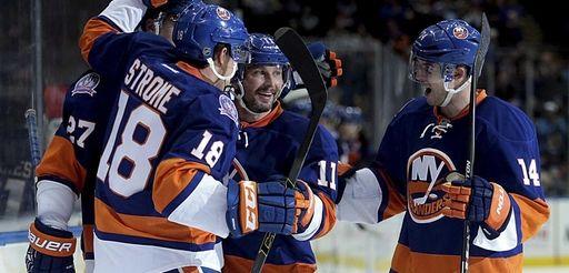 Islanders teammates celebrate center Anders Lee's score in