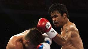 Manny Pacquiao of the Philippines, right, fights against