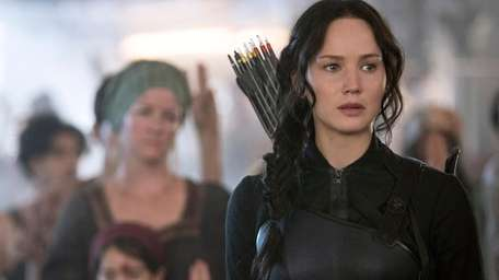 Jennifer Lawrence as Katniss Everdeen in a scene