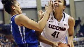 Connecticut's Kiah Stokes looks to shoot as Creighton's