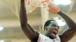 Stony Brook Seawolves forward Jameel Warney dunks during
