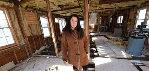 Patricia Giovinco poses at her Sandy damaged home