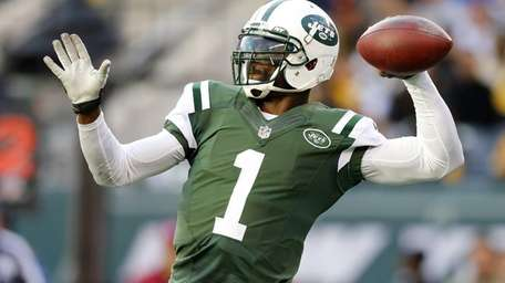 Michael Vick of the New York Jets throws