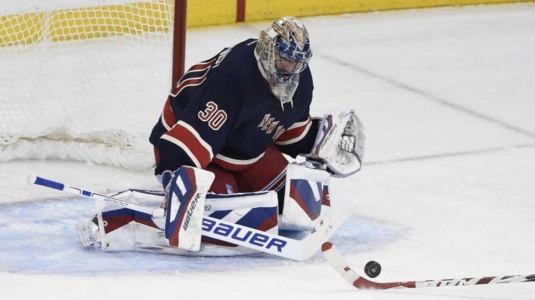 Rangers goalie Henrik Lundqvist makes a save against