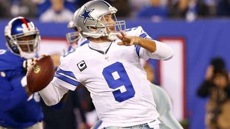 Tony Romo of the Dallas Cowboys throws a