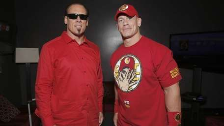 Sting, left, helped Team Cena win at WWE