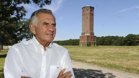 Developer Gerald Wolkoff stands at the site of