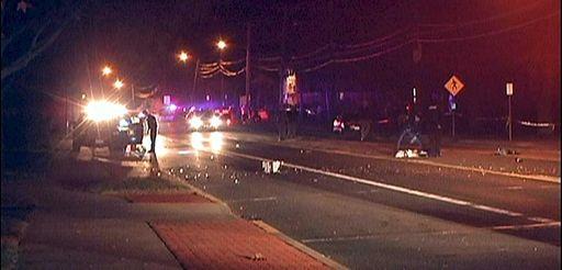 Police investigate the scene where one man was