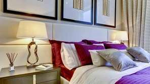 Bedside lamps and extra pillows are guest-pleasers.