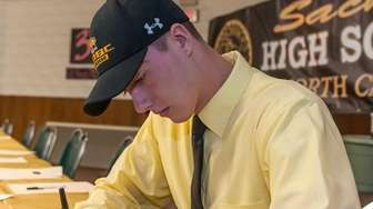 Sachem North's Ian Junge signed his letter of