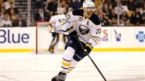 Buffalo Sabres defenseman Henrik Tallinder carries the puck