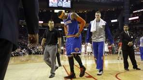 The New York Knicks' Carmelo Anthony (7) leaves