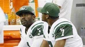 New York Jets quarterbacks Michael Vick (1) and