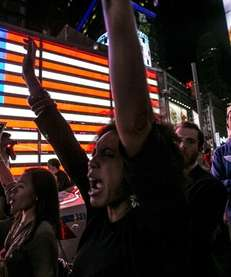 Protesters in Times Square respond to the news