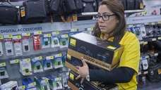 A Best Buy employee scrambles on Black Friday