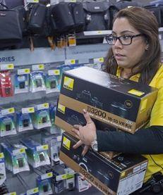 A Best Buy employee scrambles on Black Friday