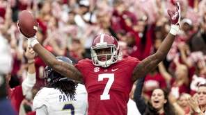 Alabama wide receiver Cam Sims (7) celebrates a