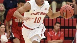 Stony Brook guard Carson Puriefoy brings the ball