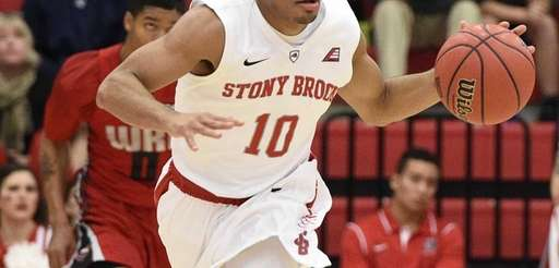 Stony Brook guard Carson Puriefoy brings the ball