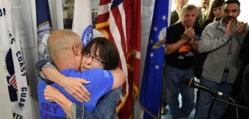 Dorine Kenney, founder of Jacob's Light Foundation, hugs