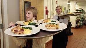 Student servers Patricia Reed, left, and Jacqueline Corsini,