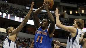 New York Knicks center Samuel Dalembert shoots as