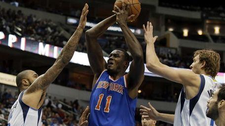 New York Knicks center Samuel Dalembert shoots as