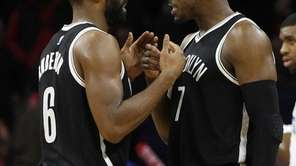 Brooklyn Nets' Alan Anderson, left, celebrates with Joe