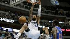 Dallas Mavericks center Tyson Chandler dunks in front