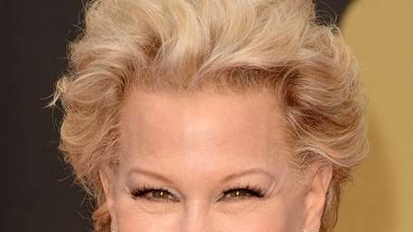 Bette Midler is seen here laughing over dinner