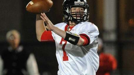 Syosset quarterback William Hogan throws a pass during