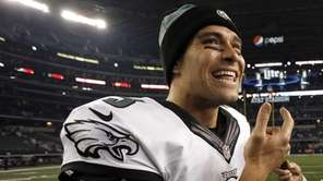 Philadelphia Eagles quarterback Mark Sanchez smiles as he