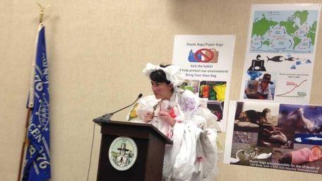 A Southampton woman wears a flowing dress made