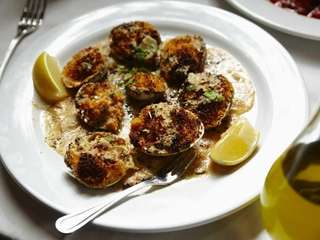 Baked clams are capped with house-made bread crumbs