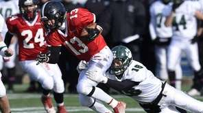 Syosset's Christian Skorka intercepts a pass against Lindenhurst's