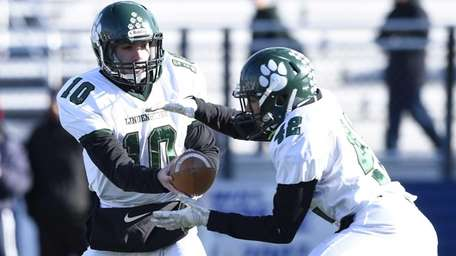 Lindenhurst's quarterback Ryan Hofmann hands the ball off