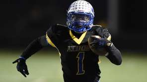 Lawrence's Jordan Fredericks runs the football against Sayville