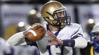 Sayville quarterback Jack Coan passes the football against