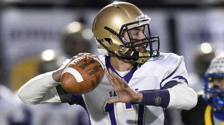 Sayville quarterback Jack Coan passes the football against