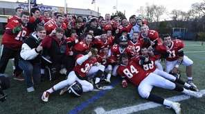 Syosset celebrates its 35-13 win against Lindenhurst in