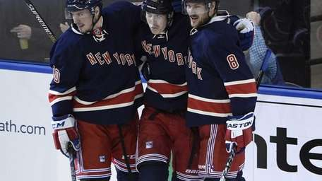 New York Rangers right wing Jesper Fast, center,