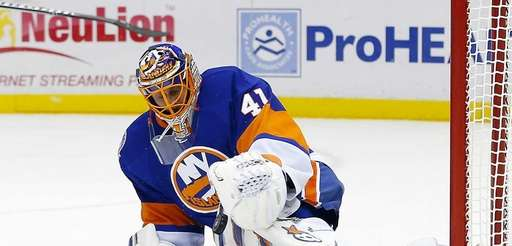 New York's Jaroslav Halak makes a save in