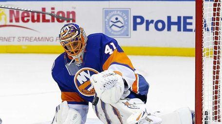 New York's Jaroslav Halak makes a save in