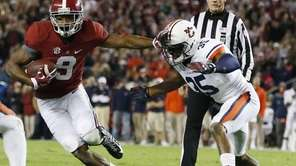 Alabama wide receiver Amari Cooper moves against Auburn