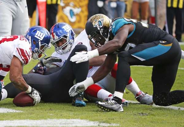 Jacksonville Jaguars outside linebacker J.T. Thomas dives in