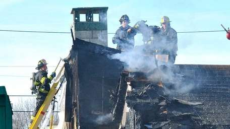 Firefighters beat back a fire Sunday morning, Nov.