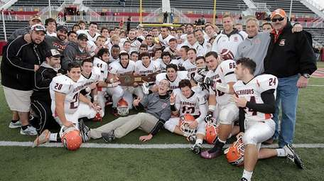 The Carey football team celebrates its victory over