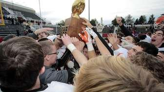 The Carey football team celebrate their victory over